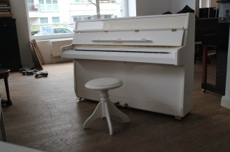 white_piano_polished
